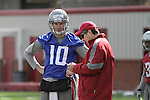 Jeff Tuel (10) confers with head coach Mike Leach during Spring football practice at Washington State University on March 24, 2012.