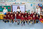 Junior infants in Miss O'Sullivans class in Mercy Moyderwell Primary school on Wednesday. L to r: Trish O'Malley (SNA),  Muinteor Ciara O'Sullivan and Moira Quinlan (Principal)