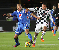 BOGOTA -COLOMBIA, 2 -AGOSTO-2014. Andres Felipe Cadavid ( I) Millonarios disputa el balón con Juan Perez  ( D ) del Chico FC durante partido de la  tercera fecha  de La Liga Postobón 2014-2. Estadio Nemesio Camacho El Campin  . /  Andres Felipe Cadavid (L) of Millonarios   fights for the ball with Juan Perez  of Chico FC  during match of the 3th date of Postobon  League 2014-2. Nemesio Camacho El Campin  Stadium. Photo: VizzorImage / Felipe Caicedo / Staff