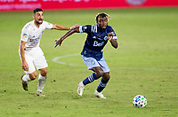 CARSON, CA - OCTOBER 18: Leonard Owusu #17 of the Vancouver Whitecaps moves with the ball past Sebastian Lletget #17 of the Los Angeles Galaxy during a game between Vancouver Whitecaps and Los Angeles Galaxy at Dignity Heath Sports Park on October 18, 2020 in Carson, California.