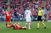 Robert Mak of Slovakia (C) sees a yellow card by referee Felix Zwayer (R) for his foul against Connor Roberts of Wales who lies on the ground during the UEFA EURO 2020 Qualifier match between Wales and Slovakia at the Cardiff City Stadium, Cardiff, Wales, UK. Sunday 24 March 2019