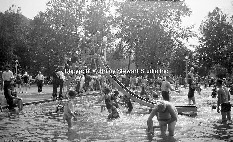 "South Park PA: Stewart children having fun at the South Park Swimming pool. The philosophy of recreation in the '20s and '30s was different than it is today. The differences between the haves and the have-nots of society were understood differently, and the county parks were called ""the people's country clubs,"" bringing to poorer people the same recreation that the wealthy paid for at private clubs: golf, tennis, swimming, picnicking. The parks offered common folk the chance to escape to rural campgrounds, day camps, and ""retreats."" Certain modern recreational concepts had not yet arrived: people didn't ""swim,"" they ""bathed""; hence, a large South Park pool was only four feet deep at its deepest point."