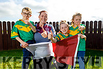 Veronica Deenihan at home in Kilmoyley wearing her Causeway jersey as her children, Isobelle, Max and Nicole wear their Kilmoyley jerseys on Sunday.