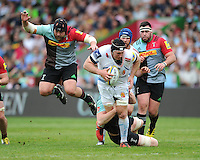 Thomas Waldrom of Exeter Chiefs is tackled as Mark Lambert of Harlequins jump out of the way during the Aviva Premiership match between Harlequins and Exeter Chiefs at The Twickenham Stoop on Saturday 7th May 2016 (Photo: Rob Munro/Stewart Communications)