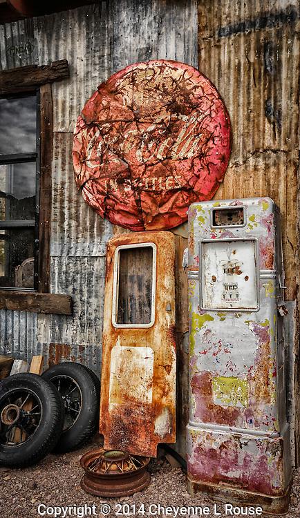 Vintage Vignette - Rusty gas pumps and Coca-Cola sign. Nevada