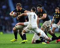 Duane Vermeulen of South Africa hands off Danny Care of England during the QBE International match between England and South Africa at Twickenham Stadium on Saturday 15th November 2014 (Photo by Rob Munro)