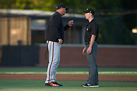 Frederick Keys manager Ryan Minor (left) argues a call with base umpire Tom Hanahan during the game against the Buies Creek Astros at Jim Perry Stadium on April 28, 2018 in Buies Creek, North Carolina. The Astros defeated the Keys 9-4.  (Brian Westerholt/Four Seam Images)