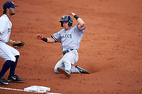 Tampa Yankees second baseman Nick Solak (39) slides into third base in front of Charlotte Stone Crabs third baseman Jim Haley (38) during the first game of a doubleheader against the Charlotte Stone Crabs on July 18, 2017 at Charlotte Sports Park in Port Charlotte, Florida.  Charlotte defeated Tampa 7-0 in a game that was originally started on June 29th but called to inclement weather.  (Mike Janes/Four Seam Images)