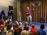 Gabe Kerschner, with Wild Things, teaches a large crowd about Archimedes, a great horned owl, during a presentation at the Carson City Library, in Carson City, Nev., on Wednesday, July 30, 2014.<br /> Photo by Cathleen Allison