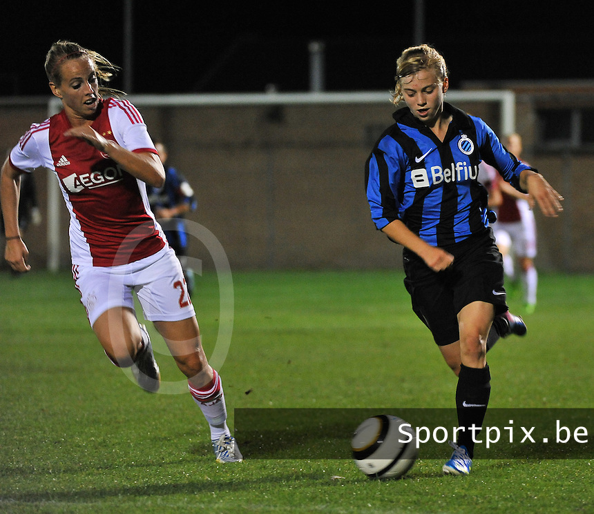 20130830 - VARSENARE , BELGIUM : Brugge's Yana Haesebroek pictured in a run along with Ajax' Whitney Sharpe (left) during the female soccer match between Club Brugge Vrouwen and Ajax Amsterdam Dames , of the first matchday in the BENELEAGUE competition. Friday 30 August 2013. PHOTO DAVID CATRY