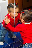 MR / Schenectady, NY. Infant (girl, 11 months, African American & Caucasian) looks at and touches her reflection in the mirror. MR: Dal4. ID: AL-HD. © Ellen B. Senisi