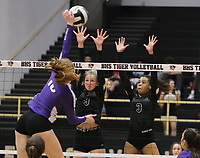 Madeline Lafata (16) of Fayetteville tries to spike through Gloria Cranney (9) and Trinity Hamilton (3) of Bentonville on Thursday, Oct.  7, 2021, during play at Tiger Arena in Bentonville. Visit nwaonline.com/211008Daily/ for today's photo gallery.<br /> (Special to the NWA Democrat-Gazette/David Beach)
