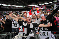 FAO: SPORTS PICTURE DESK-NO BYLINE PLEASE<br /> Pictured: Ecstatic Swansea supporters celebrating their team's win. Monday 30 May 2011<br /> Re: Reading v Swansea npower Championship play-offs final at the Wembley Stadium, London.<br /> NO BYLINE PLEASE