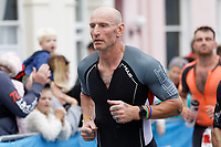 Pictured: Gareth Thomas during the last 10 kilometres of the marathon. Sunday 15 September 2019<br /> Re: Ironman triathlon event in Tenby, Wales, UK.
