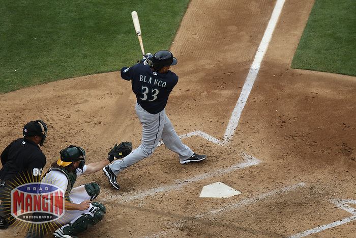OAKLAND, CA - JUNE 15:  Henry Blanco #33 of the Seattle Mariners hits a grand slam against the Oakland Athletics during the game at O.co Coliseum on Saturday June 15, 2013 in Oakland, California. Photo by Brad Mangin