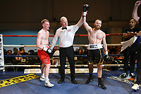 Micky Mills (black shorts) defeats Charlie Sheldon during a Boxing Show at the Corn Exchange on 25th September 2021