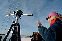 a SORAC Sea Otter Research And Conservation program researcher adjusts an antenna to pick up the signal from a sea otter radio transmitter, Monterey Bay Aquarium, California, USA, Pacific Ocean