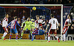 Billy McKay scores the winning goal for Inverness with an overhead kick as Rob Kiernan looks on