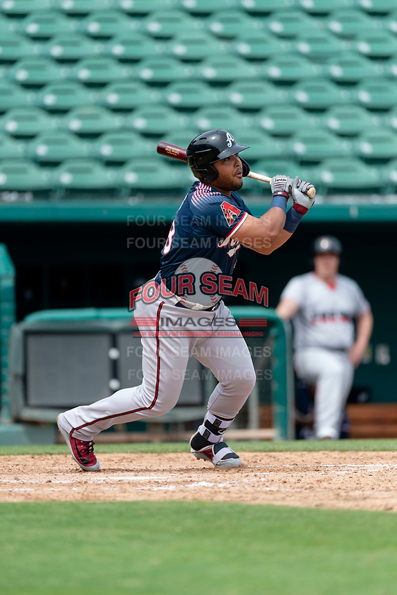 Reno Aces first baseman Yasmany Tomas (23) hits a single during a game against the Fresno Grizzlies at Chukchansi Park on April 8, 2019 in Fresno, California. Fresno defeated Reno 7-6. (Zachary Lucy/Four Seam Images)