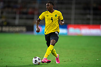 ORLANDO, FL - JULY 20: Amari'i Bell #4 of Jamaica passes the ball during a game between Costa Rica and Jamaica at Exploria Stadium on July 20, 2021 in Orlando, Florida.