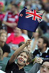 A fan of New Zealand All Blacks holds the national flag during the match of DHL Hong Kong Bledisloe Cup between New Zealand All Blacks and Australia Wallabies at Hong Kong Stadium on October 30, 2010 in Hong Kong, China.