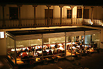 The Museo de Arte Precolombio restaurant in Cuzco, Peru lives inside an exquisite glass box that sits in the courtyard of the colonial era museum building. The museum exhibits were open in the rooms lining the courtyard.