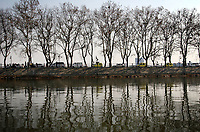 CHINA. Jiangxi Province.  Jiujiang. Cars passing through a park in the centre of the city. Jiujiang is a city of 4.6 million people, located on the southern shore of the Yangtze River.  2008