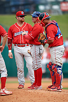 Lakewood BlueClaws manager Marty Malloy (2) makes a pitching change as first baseman Quincy Nieporte (10) and catcher Gregori Rivero (23) look on during a game against the Greensboro Grasshoppers on June 10, 2018 at First National Bank Field in Greensboro, North Carolina.  Lakewood defeated Greensboro 2-0.  (Mike Janes/Four Seam Images)
