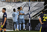 KANSAS CITY, KS - OCTOBER 11: #17 Gadi Kinda, #7 Johnny Russell and #12 Gerso Fernandes of Sporting Kansas City celebrate Gerso's goal during a game between Nashville SC and Sporting Kansas City at Children's Mercy Park on October 11, 2020 in Kansas City, Kansas.