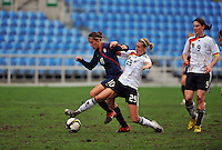 Carli Lloyd fends off a defender. The USA captured the 2010 Algarve Cup title by defeating Germany 3-2, at Estadio Algarve on March 3, 2010.