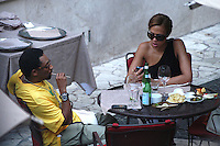 SPIKE LEE & TONYA LEWIS LEE.The Film Award Sesterzio Silver 2008 held at the Jardin de Russie,.Rome 24th June 2008..half length wife married husband wife yellow t-shirt table sitting food drink wine sunglasses .CAP/CAV.©Luca Cavallari/Capital Pictures