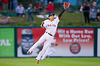 Shortstop Jose Iglesias #10 of the Pawtucket Red Sox leaps in an attempt to catch a line drive against the Charlotte Knights at McCoy Stadium on June 14, 2011 in Pawtucket, Rhode Island.  The Knights defeated the Red Sox 4-2 in 11 innings.    Photo by Brian Westerholt / Four Seam Images