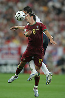 Portuguese midfielder (8) Petit goes up for a header against English midfielder (8) Frank Lampard.  Portugal defeated England on penalty kicks after playing to a 0-0 tie in regulation in their FIFA World Cup quarterfinal match at FIFA World Cup Stadium in Gelsenkirchen, Germany, July 1, 2006.