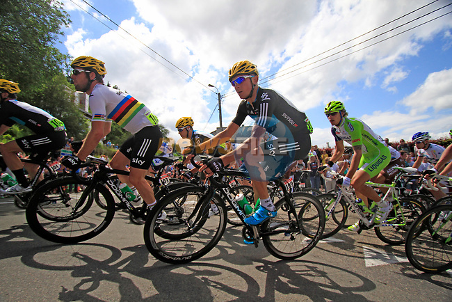 The peloton including Sky Procycling's World Champion Mark Cavendish (GBR) and Kanstantsin Sivtsov (BLR) round a hairpin to climb the Cote de Lierneux during Stage 1 of the 99th edition of the Tour de France, running 198km from Liege to Seraing, Belgium. 1st July 2012.<br /> (Photo by Eoin Clarke/NEWSFILE)