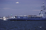 """The French war ship """"Jeanne De Arc""""seen from the stern sits at anchor in New York Harbor. The ship is seen during  the celebration for the Statue of Liberty, on July 5th in 1986. The statue surrounded by other vessels , is seen in the backround."""
