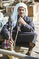 Abu Dhabi, UAE, March 1972. Emirati Sailor with Sheesha.