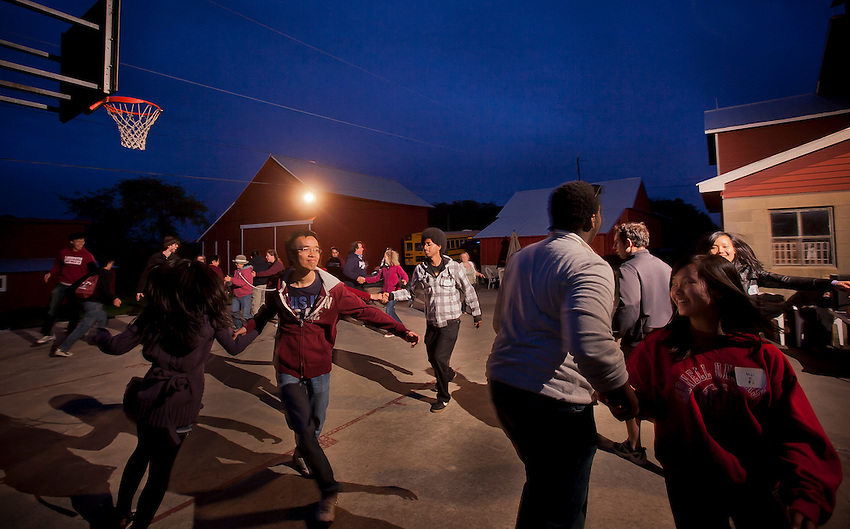 International Students Association Discover America event:  At the farm of Marie Wildasin, in rural Easton International students were hosted to a Discover America event where they had a cookout, an Easter Egg hunt, made s'mores, had a tug of war and finally learn to square dance . Here the students Square Dance....Chuck Zovko / Zovko Photographic llc.APril 28, 2012