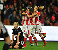 20131009 - LIEGE , BELGIUM : Standard players pictured celebrating the 1-0 with Standard's Tessa Wullaert (right) during the female soccer match between STANDARD Femina de Liege and GLASGOW City LFC , in the 1/16 final ( round of 32 ) first leg in the UEFA Women's Champions League 2013 in stade Maurice Dufrasne - Sclessin in Liege. Wednesday 9 October 2013. PHOTO DAVID CATRY