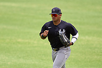 New York Yankees outfielder Jasson Dominguez (25) jogs to the dugout during an Extended Spring Training game against the Detroit Tigers on June 19, 2021 at the Joker Marchant Stadium in Lakeland, Florida.  (Mike Janes/Four Seam Images)