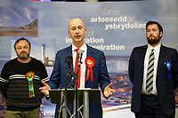 Pictured: Geraint Davies (C) gives a speech after winning the Swansea West seat for the Labour party in front of Mike O'Carroll of the Liberal Democrats (L) and James Price for the Conservatives. Friday 13 December 2019<br /> Re: Ballots count at the Leisure Centre in Swansea, Wales, UK.