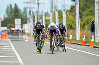 Riders sprint to the finish of stage five of the 2018 NZ Cycle Classic UCI Oceania Tour (Masterton criterium) in Masterton, New Zealand on Friday, 21 January 2018. Photo: Dave Lintott / lintottphoto.co.nz