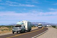 Recreational Vehicles travelling on Highway through the Mojave Desert, Southern California, CA, USA, ca. April 2012