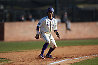 Travis Holt (8) of the High Point Panthers takes his lead off of third base against the Bryant Bulldogs at Williard Stadium on February 21, 2021 in  Winston-Salem, North Carolina. The Panthers defeated the Bulldogs 3-2. (Brian Westerholt/Four Seam Images)