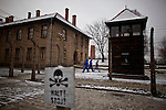 Visitors at the Auschwitz I concentration camp Sunday Dec 28 2014. Auschwitz concentration camp was a network of German Nazi concentration camps and extermination camps built and operated by the Third Reich in Polish areas annexed by Nazi Germany during World War II, the camp was liberated on January 27, 1945 by Soviet troops. Photo By Eyal Warshavsky