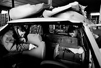 Italy. Veneto Region. Vicenza. Cars scrapyard. Two workers cut out the polyurethane foam from the cars seats for future recycling. © 1993 Didier Ruef .