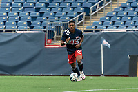 FOXBOROUGH, UNITED STATES - MAY 28: Francois Dulysse #60 of New England Revolution II brings the ball forward during a game between Fort Lauderdale CF and New England Revolution II at Gillette Stadium on May 28, 2021 in Foxborough, Massachusetts.