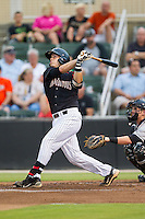 Brett Austin (10) of the Kannapolis Intimidators follows through on his swing against the Delmarva Shorebirds at CMC-NorthEast Stadium on July 3, 2014 in Kannapolis, North Carolina.  The Shorebirds defeated the Intimidators 6-5. (Brian Westerholt/Four Seam Images)