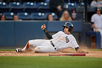 Scranton/Wilkes-Barre RailRiders second baseman Tyler Wade (23) slides home safely during a game against the Pawtucket Red Sox on May 15, 2017 at PNC Field in Moosic, Pennsylvania.  Scranton defeated Pawtucket 8-4.  (Mike Janes/Four Seam Images)