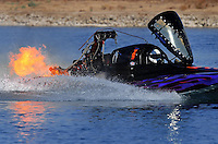 Nov. 22, 2008; Chandler, AZ, USA; IHBA top fuel hydro driver Greg Tedesco has an engine fire as he coasts to a stop during qualifying for the Napa Auto Parts World Finals at Firebird Lake. Mandatory Credit: Mark J. Rebilas-