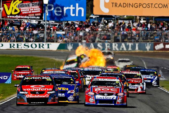 Firey crash involving Karl Reindler and Steve Owen during the start of Race 8 of the 2011 V8 Supercar Championship Series
